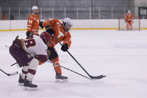 UT's Joe Kurita fights for the puck with Texas State's Luis Lopez in Friday's game.