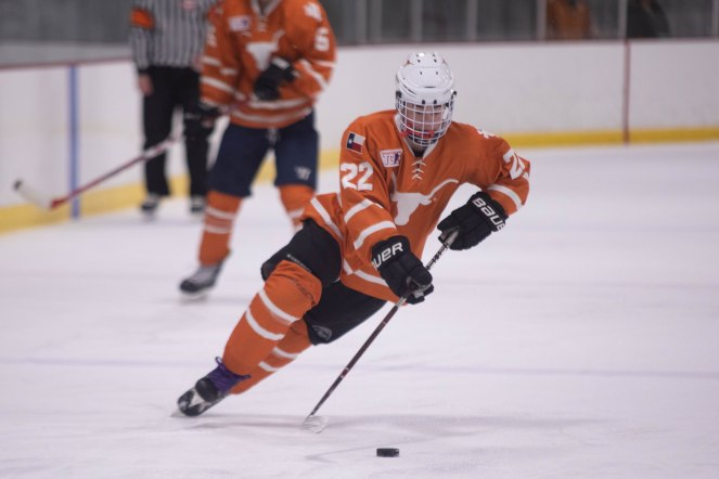 UT's David Quirarte brings the puck down ice in Friday's game against Texas State.