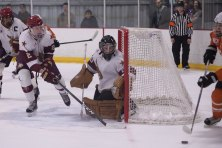 Texas State goalie, Matt Padgett, get's help defending the net from Ryan Dupre in Friday's game.