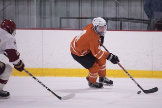 UT's Ben Wallace brings the puck out of his own end in Friday's game.