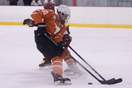 UT's Nic Samadian fights for the puck in Friday's game.