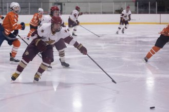A Texas State player skates toward the puck in Friday's game against UT.