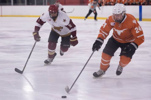 Texas State's Arthur Hatgis comes up behind a UT player in Friday night's game.