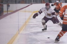 Texas State forward, Jacob Kolodziejski fights for the puck along the boards Friday night against UT.
